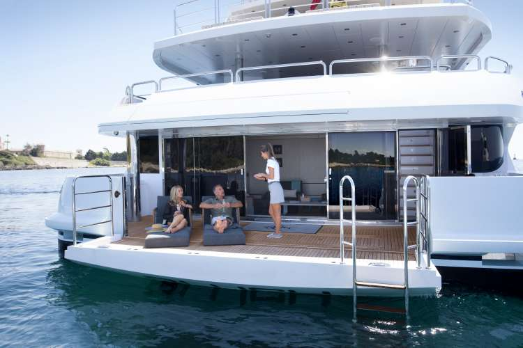 People relaxing on a bathing platform from Phoenix Marine Solutions