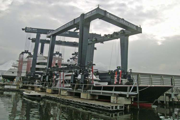 Boat lift at Derecktor shipyard with a Mega yacht in the background.