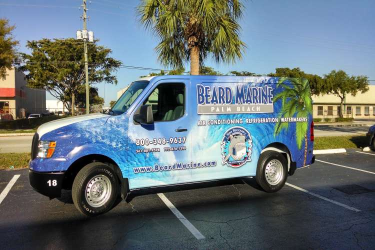 Beard Marine Palm Beach van on the parking lot next to the office building.