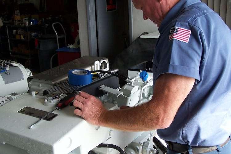 An engineer doing maintenance on an engine