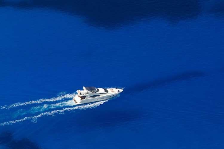 Superyacht cruising in a deep blue sea.