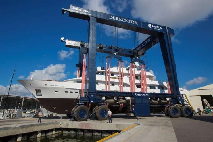 Yacht on a travel lift at Derecktor shipyard in Dania, Florida.