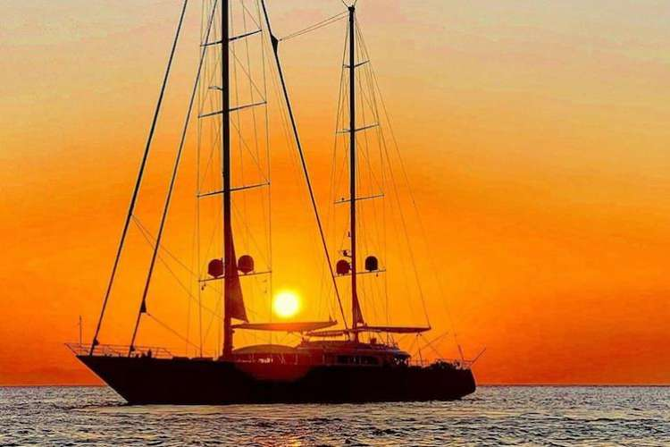 Sailing boat in a sunset.