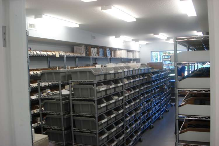 Image of a large Beard Marine inventory storage room with shelfs full of spare parts.