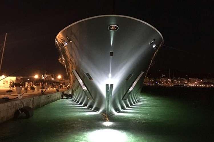 Illuminated superyacht berthing during the night