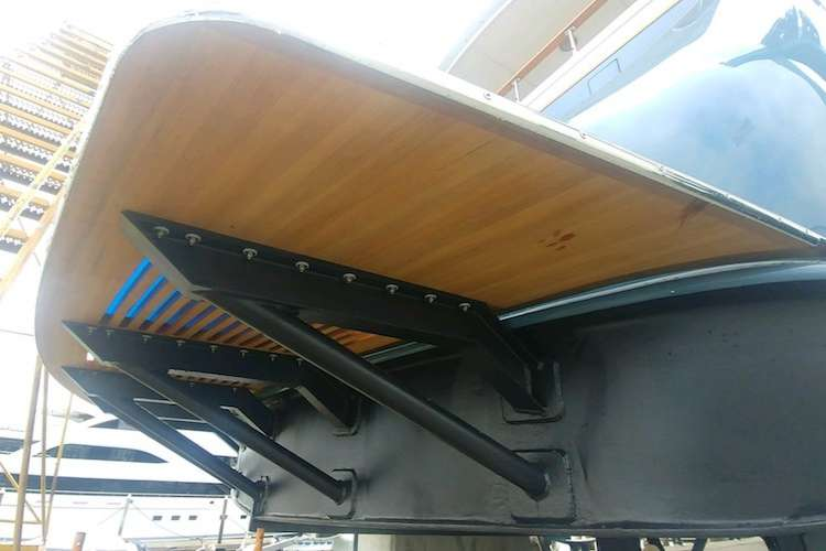 Custom made swimming platform installed to the back of a superyacht