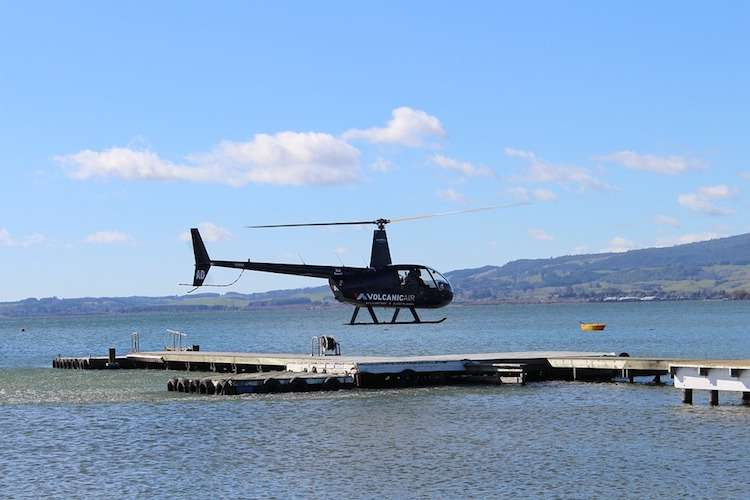 Helicopter landing in a landing spot at a sea