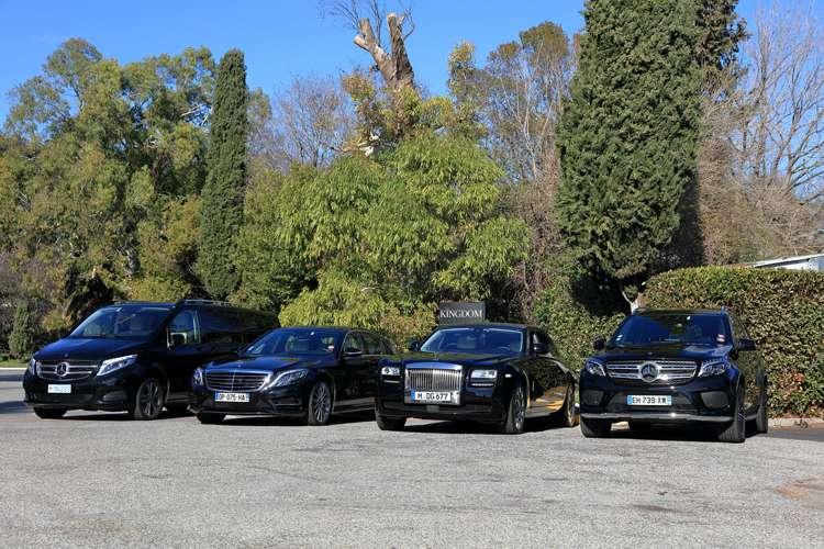 Kingdom Limousine luxury cars lined up in a row in a car park