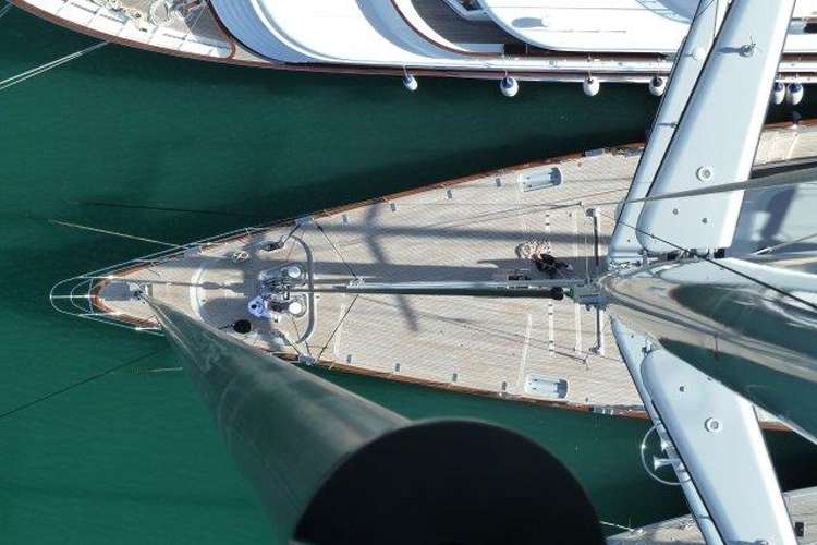 Sailing mast and a yacht from top of the mast.