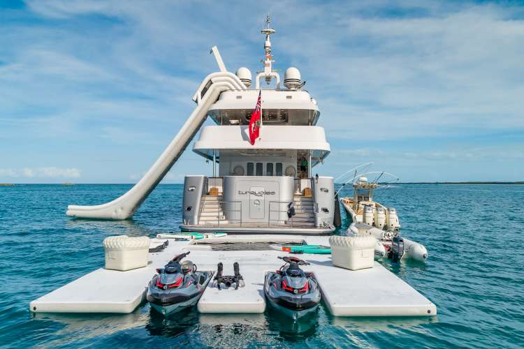 AquaBanas water slide mounted on a superyacht and waterjets parked in a PWC BOB Bana