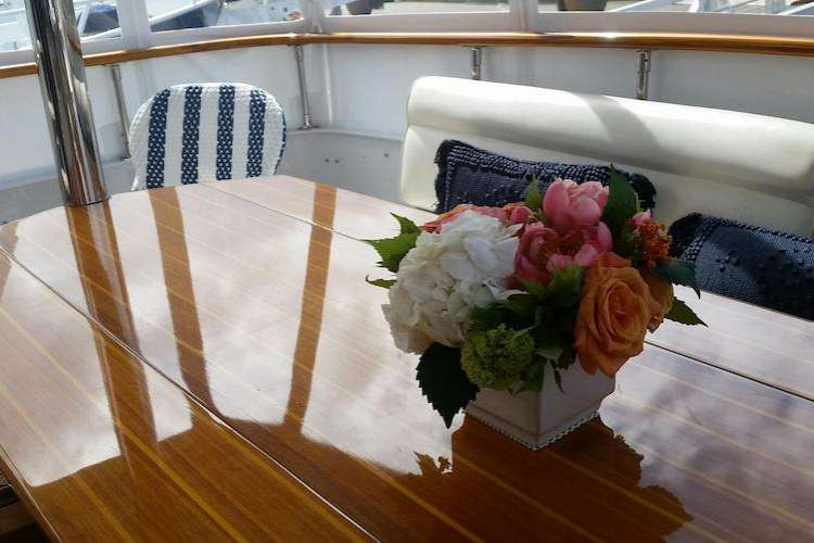 Flower arrangement on a table on a yacht deck