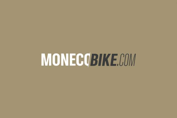 MonecoBike logo on a light brown background