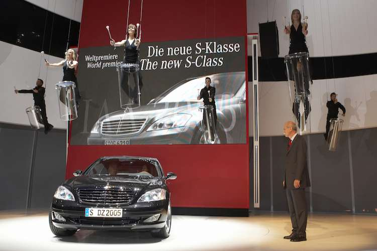 Image of a Mercedes S Class car show with an acrobatic performance.