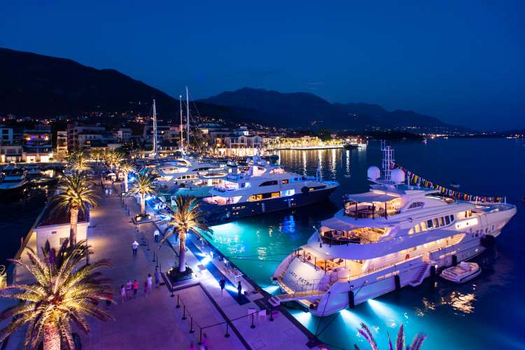 Image of superyachts berthing in a port in Montenegro in the evening