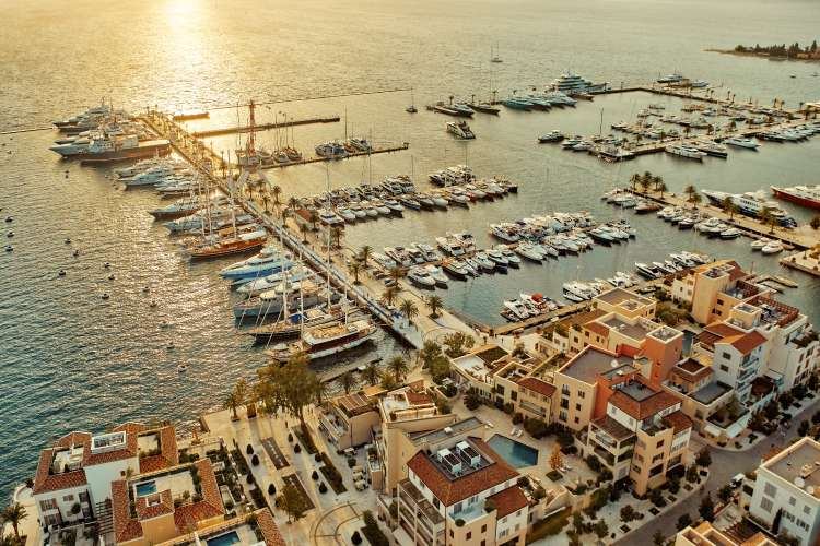 Aerial image of a port in Montenegro in sunset.