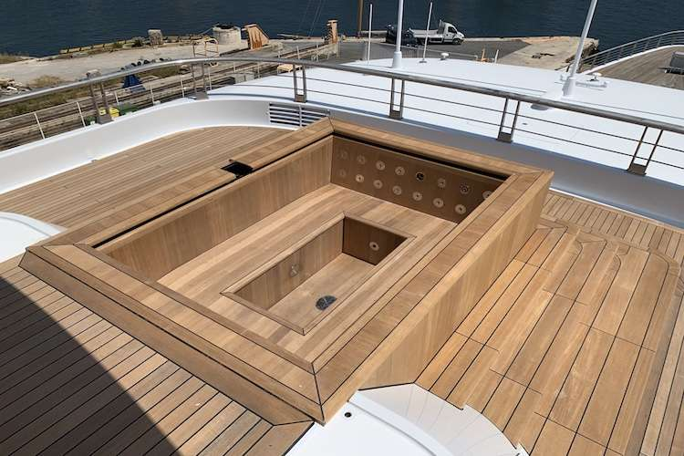 Bespoke wooden jacuzzi on a superyacht deck.