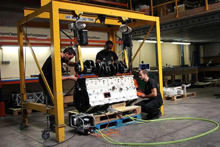 Team of AJ Marine engineers working on overhaul of equipment in their (1800m2) workshop.
