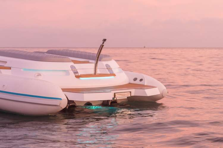 Stern of a Ribeye boat in pink sunset light