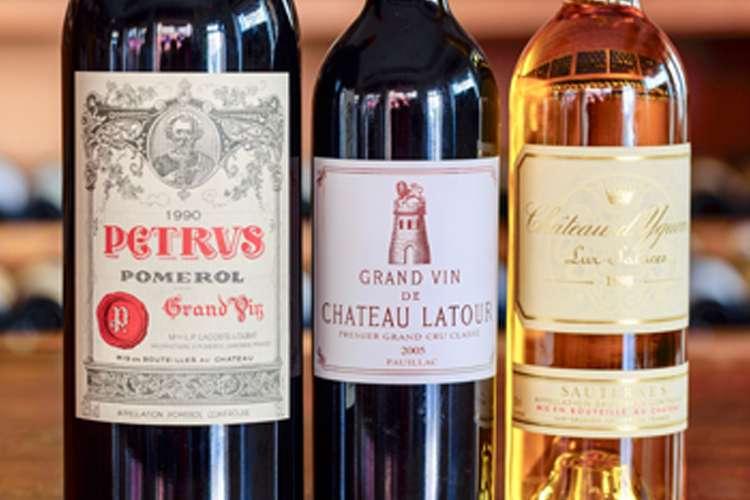 3 wine bottles Petrus Pomerol, Grand Vin Chateau Latour and Chateau d'Yguyens Lur Saluces