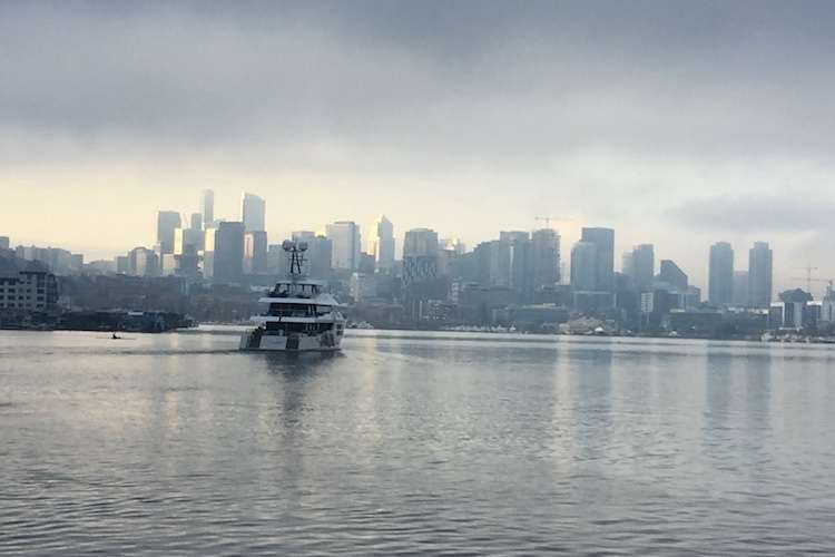 A ship anchored in the sea with Seattle city in the back ground