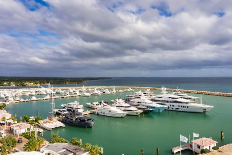 Image of superyachts berthing in the marina