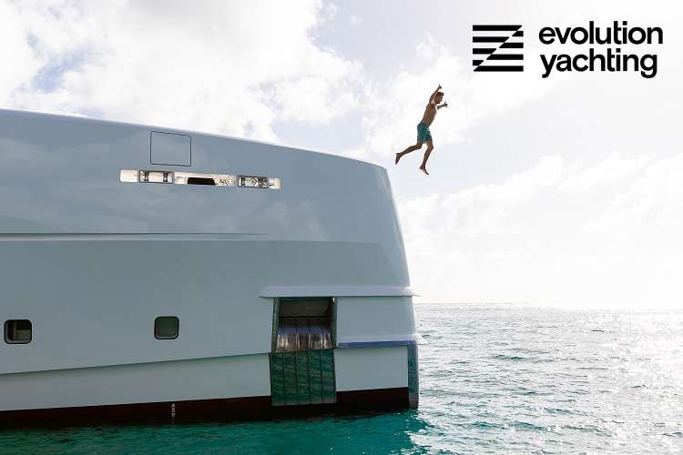 Man jumping from the bow of a superyacht