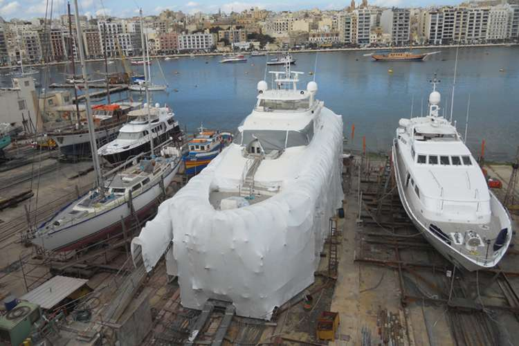 Superyacht dry docking with a protection cover at the Manoel Island shipyard