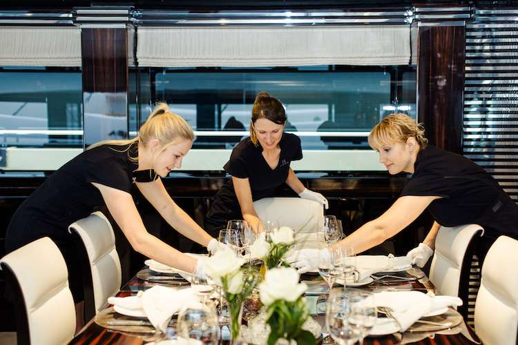Stewardesses setting the dinner table
