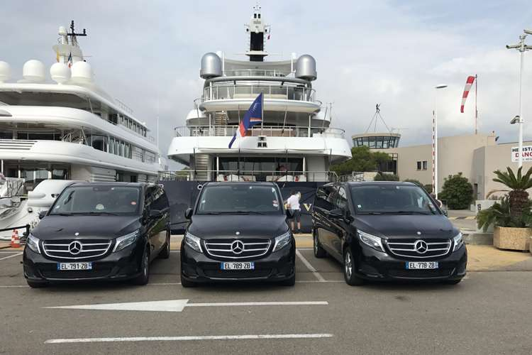 3 luxury cars parked at the back of a superyacht