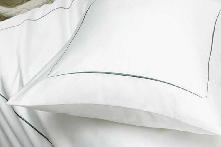 Luxurious white linen on from Boutsen Design