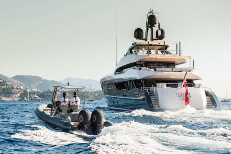 Ribeye tender cruising next to a superyacht