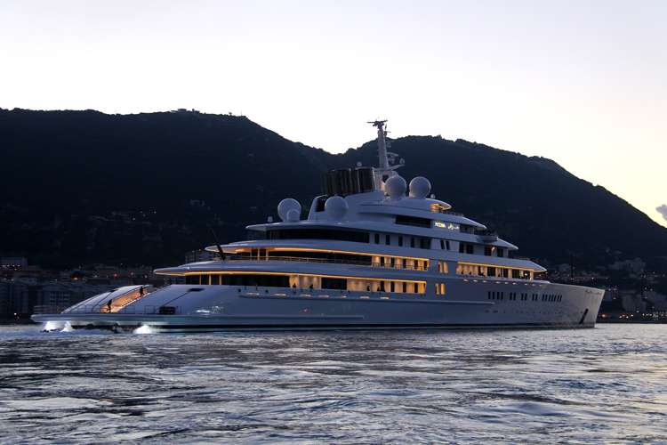 Mega yacht cruising in the  dust of an evening