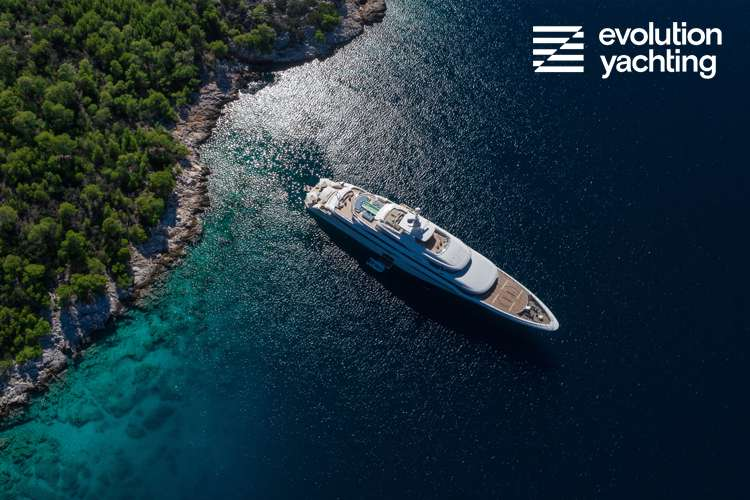 Superyacht at anchor close to the land viewing from a birds eye view