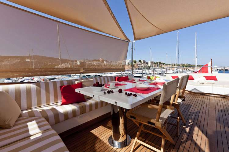 Superyacht sun deck  dining area covered by awnings from Universal Nautic
