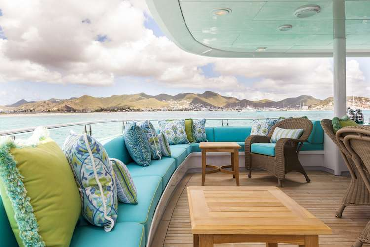 Turquoise sundeck sofa along the deck side with colourful throw pillows