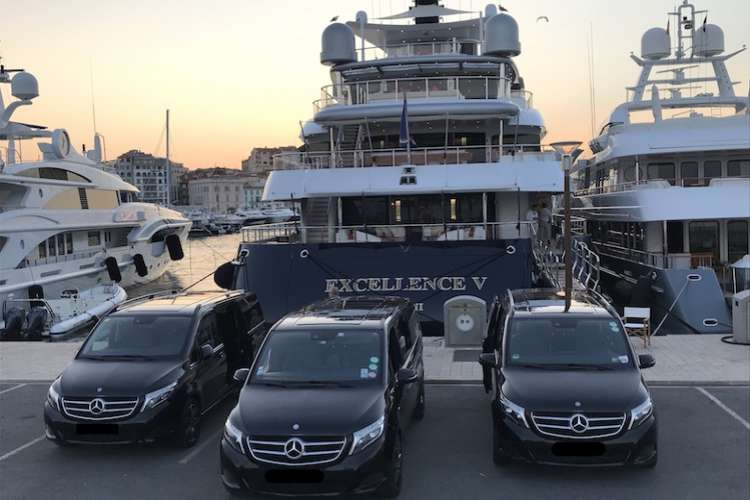 Three Ruby Services Mercedes vans parked in front of a berthing superyacht