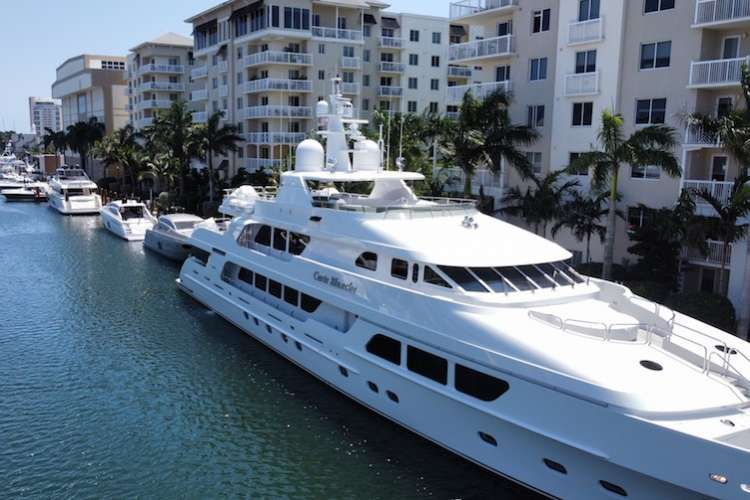 Superyacht docking next to high buildings