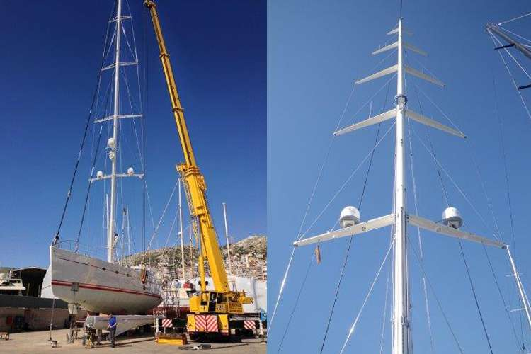 Sailing yacht and a lift in a shipyard.