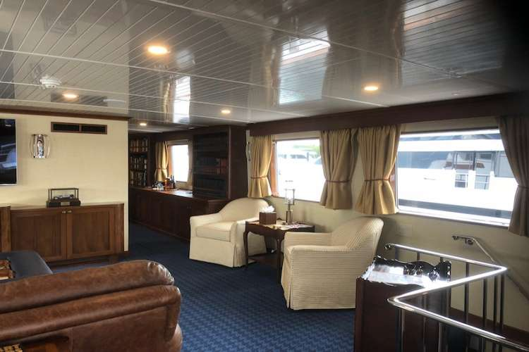 Living area in a superyacht with leather couches