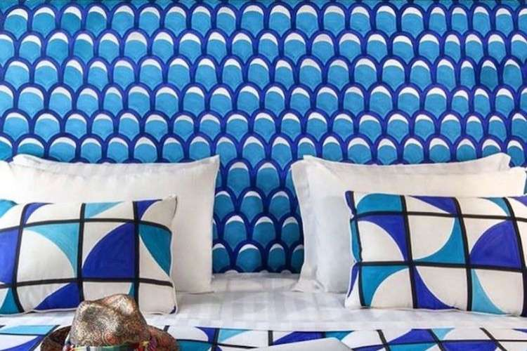 Turquoise lounge seat with blue and white pillows