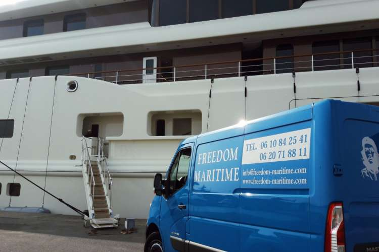 Freedom Maritime van delivering supplies to a mega yacht.