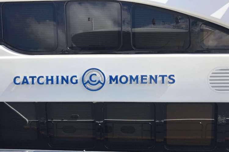 Blue yacht lettering on mega yacht Catching Moments