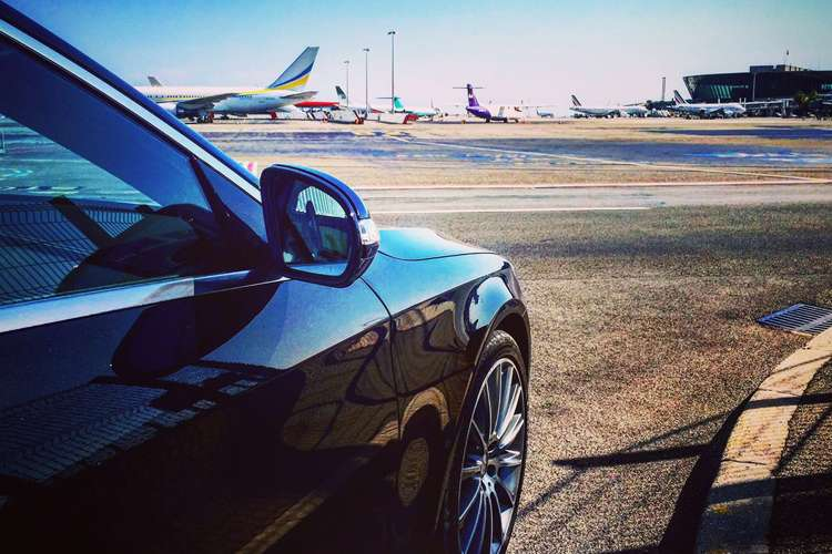 luxury car at an airport