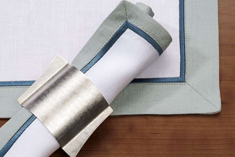 Table linen and a napkin in a silver napkin ring