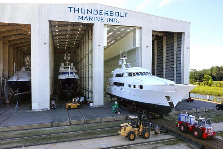 Thunderbolt Marine shipyard hangar with three superyachts