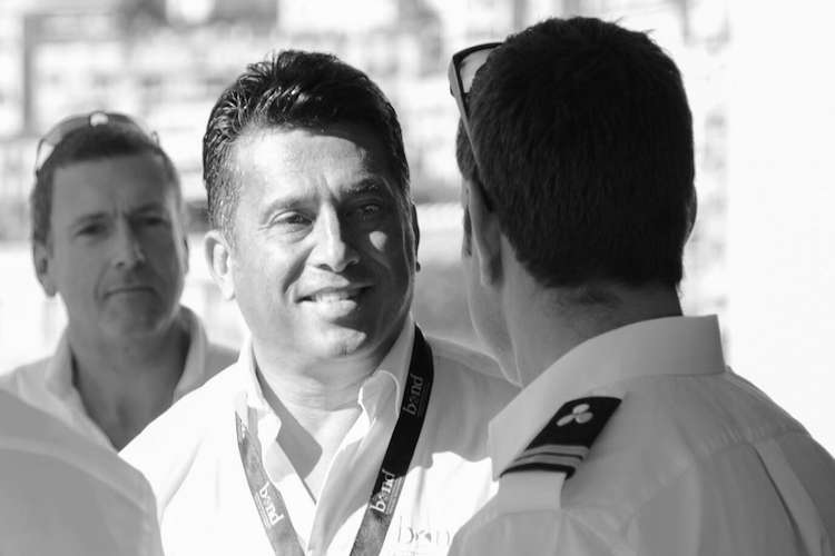 Black and white Image of a superyacht captain talking with Will Faimatea, the founder of Bond TM.