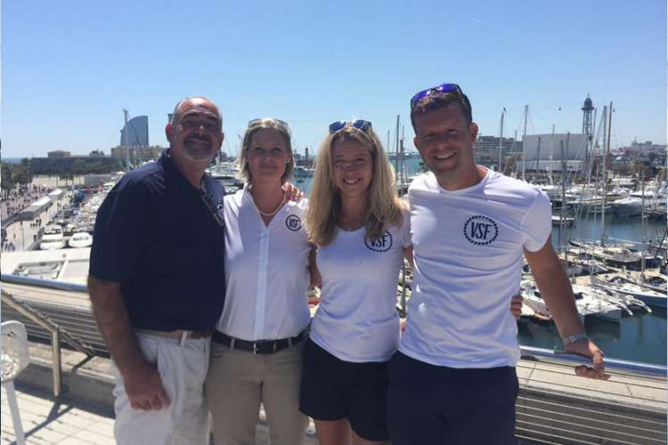 Image of the VSF team smiling and standing close to each other at port of Antibes.