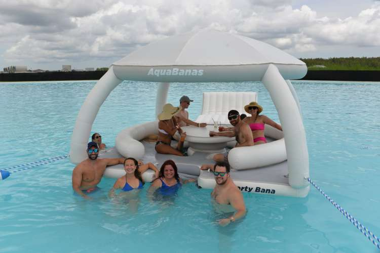 Group of friends spending time on the Party Bana in a turquoise water