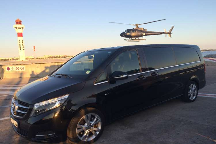 Luxury Van parked with a helicopter flying above