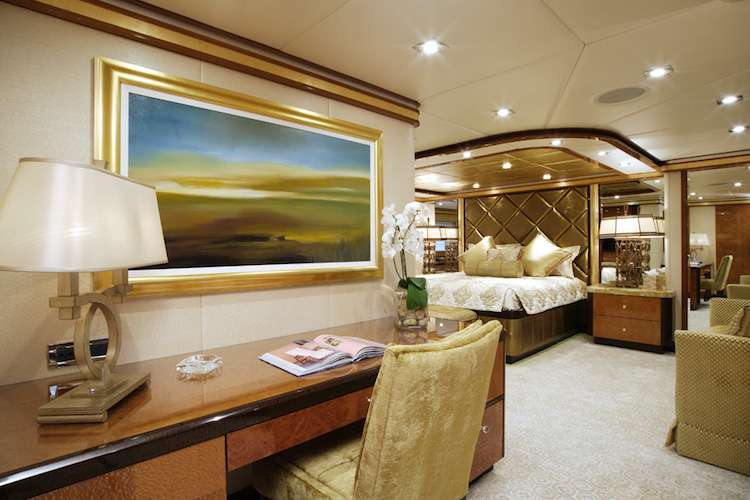 Image of a superyacht master bed room with interior design by Karen Lynn.